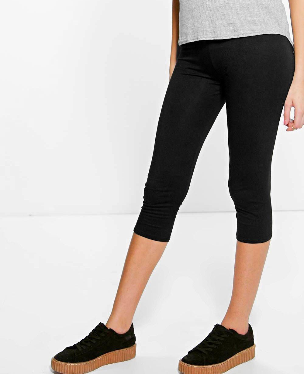 Side Slashed Black Capri Leggings Model is wearing a One Size. Measurements are 32A x 24 x 35 and height is 5' 7
